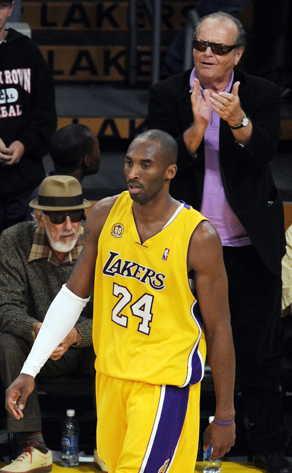 Actor Jack Nicholson, top right, applauds Los Angeles Lakers' Kobe Bryant after he scored during the second half of Game 2 of the NBA Western Conference basketball finals against the San Antonio Spurs, in Los Angeles, Friday, May 23, 2008. Looking on at left is producer Lou Adler.  (AP Photo/Chris Pizzello)