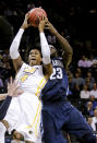 Virginia Commonwealth's Justin Tillman (4) and Villanova's Daniel Ochefu (23) fight for control of the ball during the first half of an NCAA college basketball game Monday, Nov. 24, 2014, in New York. (AP Photo/Frank Franklin II)