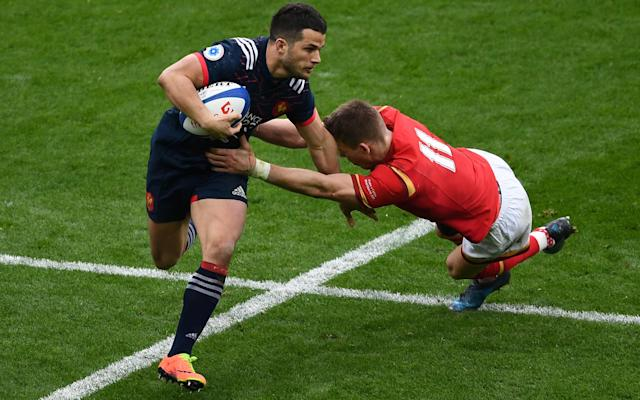 <span>Brice Dulin escapes the attention of Liam Williams</span>