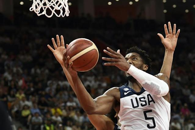 Donovan Mitchell led Team USA in scoring against France with 29 points, but it wasn't enough (AFP Photo/Ye Aung Thu )