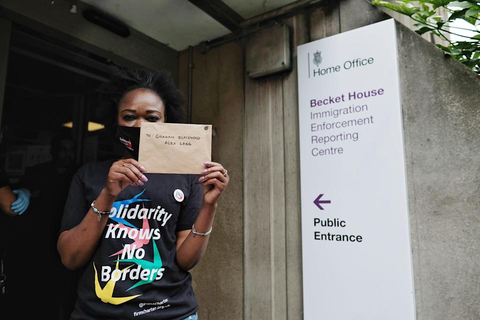 A protestor attempts to deliver a letter to the centre's managers (Angela Christofilou)