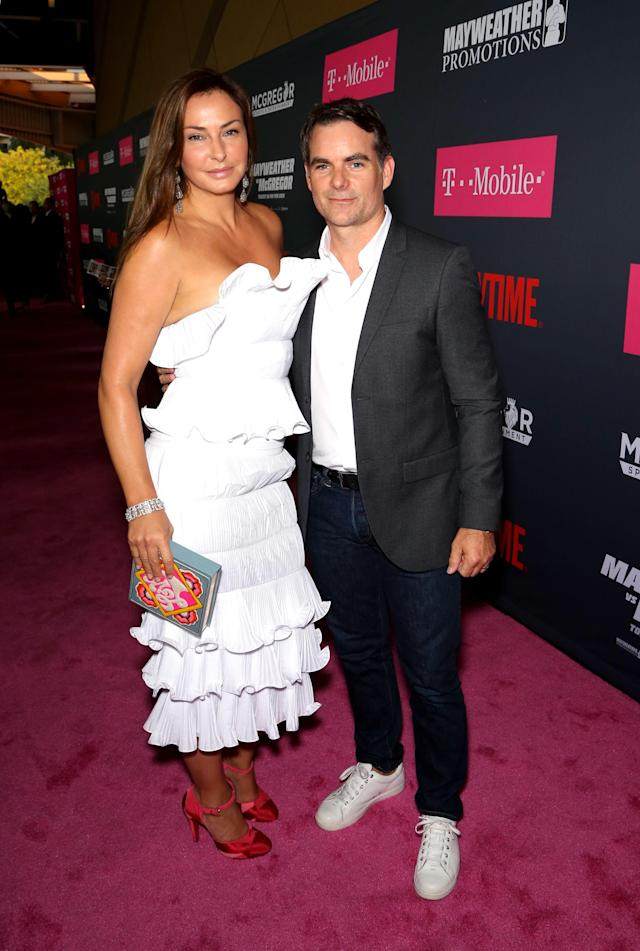 <p>NASCAR driver Jeff Gordon (R) and guest arrive on T-Mobile's magenta carpet duirng the Showtime, WME IME and Mayweather Promotions VIP Pre-Fight Party for Mayweather vs. McGregor at T-Mobile Arena on August 26, 2017 in Las Vegas, Nevada. (Photo by Gabe Ginsberg/Getty Images for Showtime) </p>