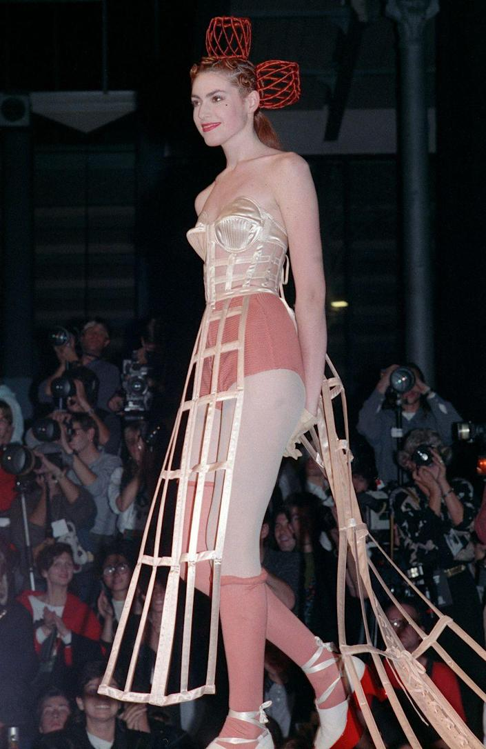 <p>A model wears a silk bustier and crinoline at the Jean Paul Gaultier spring 1989 fashion show. </p>
