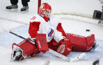 Russia's goalie Anna Prugova reacts after letting in a goal during third period during the third period of an IIHF Women's World Championship hockey game against the United States, Tuesday, Aug. 24, 2021 in Calgary, Alberta. (Jeff McIntosh/The Canadian Press via AP)