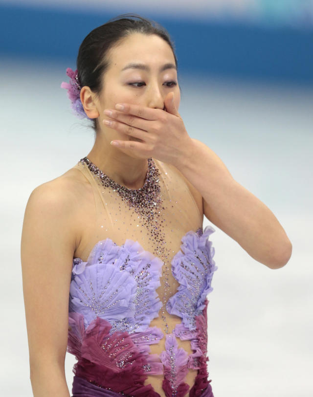 Mao Asada of Japan leaves the ice after competing in the women's team short program figure skating competition at the Iceberg Skating Palace during the 2014 Winter Olympics, Saturday, Feb. 8, 2014, in Sochi, Russia. (AP Photo/Ivan Sekretarev)