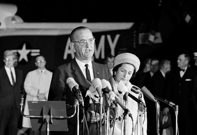 <p>The new president of the United States, Lyndon B. Johnson, speaks at Andrews Air Force Base upon his return to Washington from Dallas, where President John F. Kennedy was shot to death, Nov. 22, 1963. Beside him is new first lady, Lady Bird Johnson. (Photo: AP) </p>