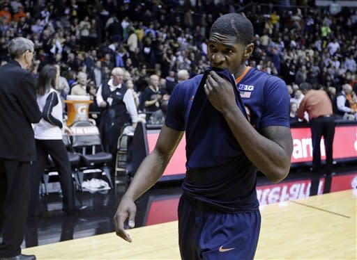 Illinois guard Brandon Paul wipes his face as he leaves the court after losing to Purdue in an NCAA college basketball game in West Lafayette, Ind., Wednesday, Jan. 2, 2013. Purdue defeated Illinois 68-61. (AP Photo/Michael Conroy)