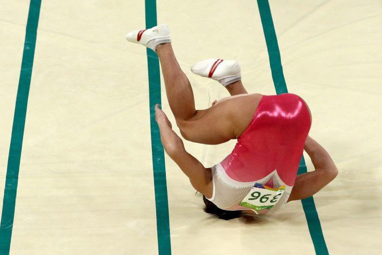 Oksana Chusovitina of Uzbekistan falls while competing in the Women's Vault Final. (Getty)
