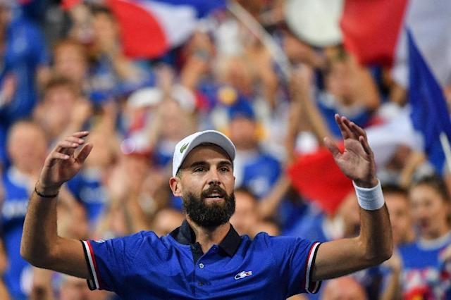 Benoit Paire celebrates after his dream Davis Cup debut for France (AFP Photo/Philippe HUGUEN)