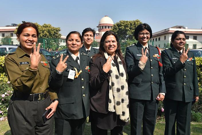 Lt. Col. Seema Singh (2R) and other women army personnel show victory signs with their lawyer Meenakshi Lekhi (C) after the apex court's decision to apply permanent commission to all women officers in the Indian Army, at Supreme Court on February 17, 2020 in New Delhi, India. (Photo by Sanchit Khanna/Hindustan Times)