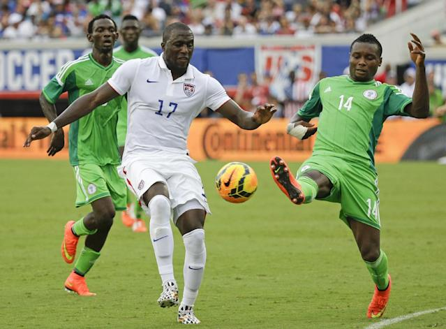 United States' Jozy Altidore (17) and Nigeria's GoDrey Oboabona (14) vie for control of the ball during the second half of an international friendly soccer match in Jacksonville, Fla., Saturday, June 7, 2014. The United States won 2-1. (AP Photo/John Raoux)