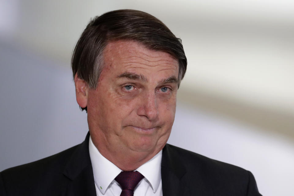 Brazil's President Jair Bolsonaro for a ceremony on digital social savings and the payment of aid to families amid the COVID-19 pandemic, in Brasilia, Brazil, Wednesday, Nov. 4, 2020. (AP Photo/Eraldo Peres)