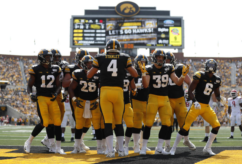 Iowa quarterback Nate Stanley directs the team in a huddle during the second half of an NCAA college football game, Saturday, Sept. 7, 2019, in Iowa City. Iowa won 30-0. (AP Photo/Matthew Putney)