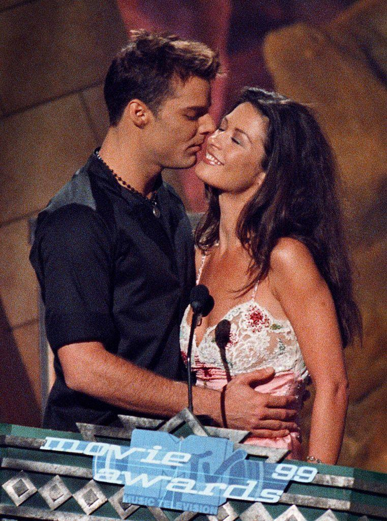 <p>The presenters for the Best Kiss award got into the swing of things before handing over the gong to winners, Gwyneth Paltrow and Joseph Fiennes for Shakespeare In Love.</p>