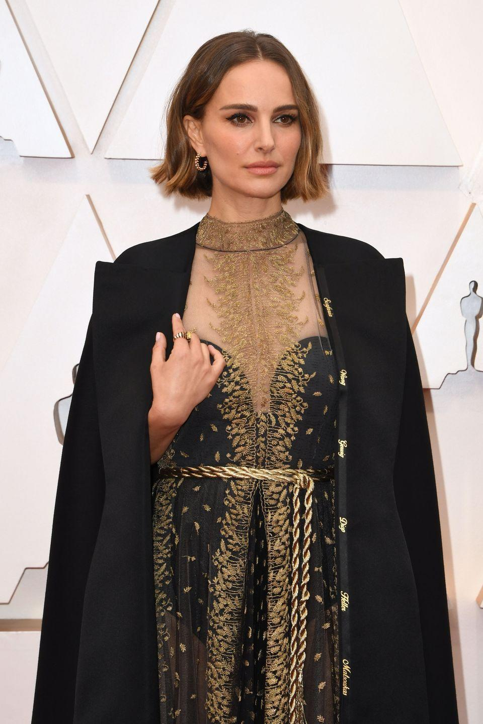 """<p>Natalie Portman used her Oscars outfit by Dior to call attention to the fact that the year's Best Director nominees were all men. Along the lining of her cape, she had names of female directors embroidered in gold. She <a href=""""https://www.harpersbazaar.com/celebrity/latest/a30839778/natalie-portman-female-directors-cape-oscars-2020/"""" rel=""""nofollow noopener"""" target=""""_blank"""" data-ylk=""""slk:explained ahead of the ceremony"""" class=""""link rapid-noclick-resp"""">explained ahead of the ceremony</a>, """"I wanted to recognize the women who were not recognized for their incredible work this year in my subtle way.""""</p>"""