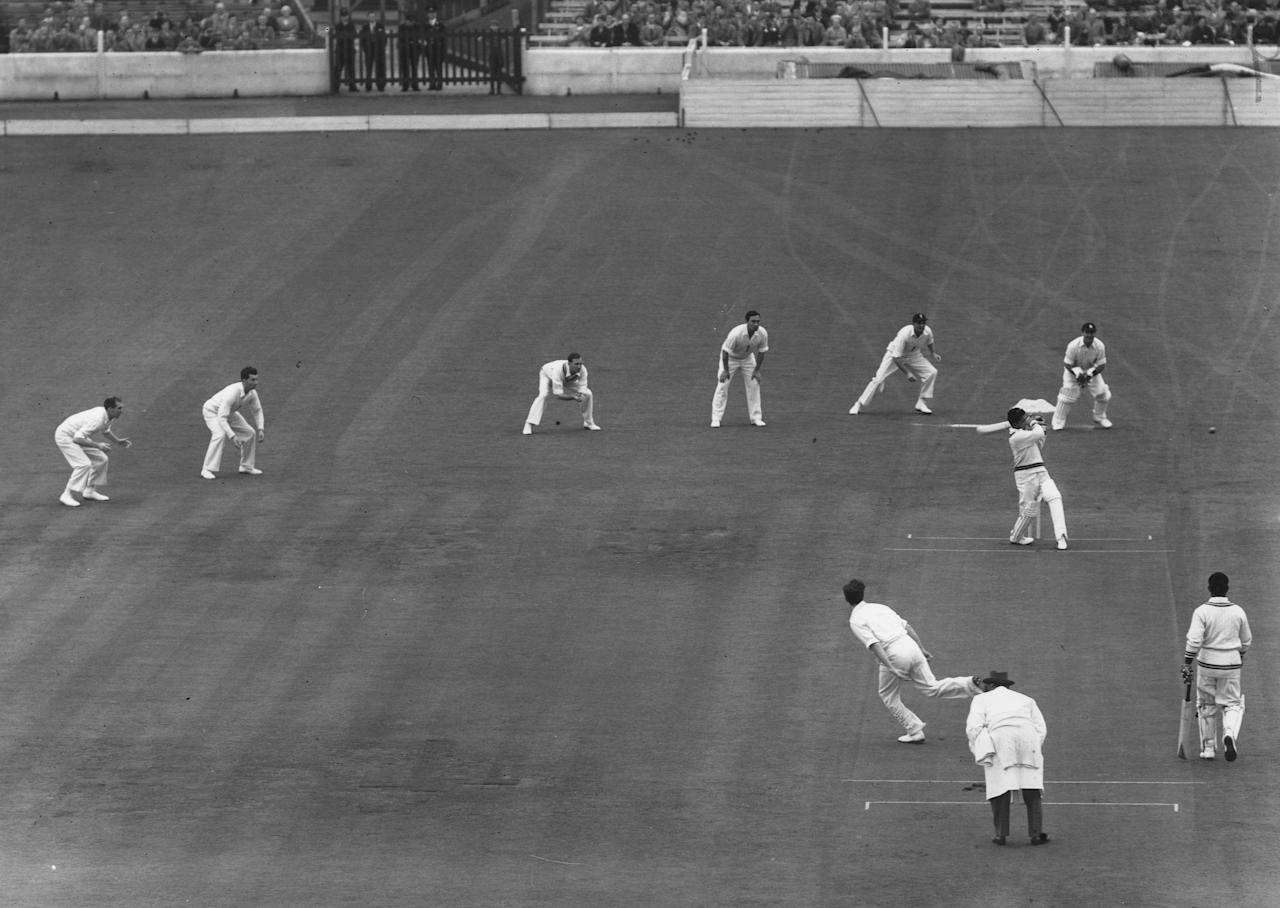 12 Aug 1954:  Pakistan's Hanif Mohammed pulls a ball square from Brian Statham at the start of the day's play in the final Test Match at the Oval. Mandatory Credit: Allsport Hulton/Archive