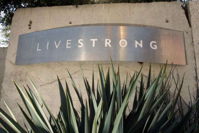 """Signage for the Livestrong Foundation appears at the charity's headquarters, Sunday, Jan. 13, 2013, in Austin, Texas. In what's been billed as a """"no-holds barred"""" session, Lance Armstrong is expected to reverse course after a decade of denials and apologize for doping, as well as offer a limited confession about his role at the head of a long-running scheme to dominate the Tour de France with the aid of performance-enhancing drugs, in an interview Monday with Oprah Winfrey. (AP Photo/Jack Plunkett)"""