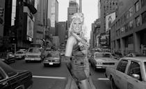 """<p>Right before Ru's hit song """"Supermodel (You Better Work)"""" rocked the charts, she posed right in the middle of NYC's Times Square. </p>"""