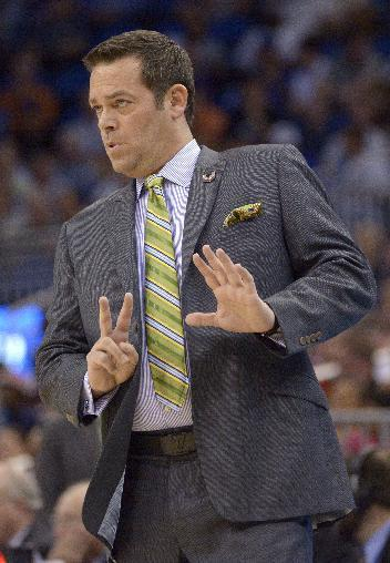 Manhattan coach Steve Masiello gestures to his team during the first half against Louisville, in a second-round game in the NCAA college basketball tournament Thursday, March 20, 2014, in Orlando, Fla. (AP Photo/Phelan M. Ebenhack)