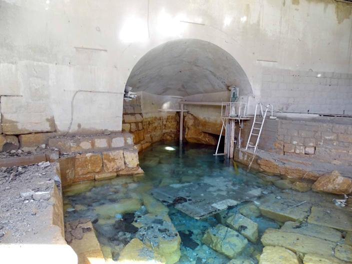 Damage is seen in the water pumping station in the village of Ain al-Fija