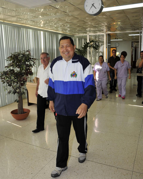 In this photo released by Cubadebate and taken by Estudios Revolucion, Venezuela's President Hugo Chavez walks in the hospital in Havana, Cuba, Friday March 2, 2012. Chavez said Friday he's recovering quickly from tumor surgery in Cuba. (AP Photo/Estudios Revolucion)