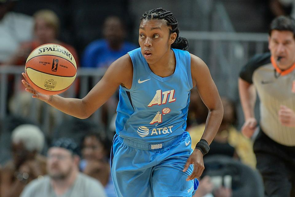 Renee Montgomery with the ball in her hand.