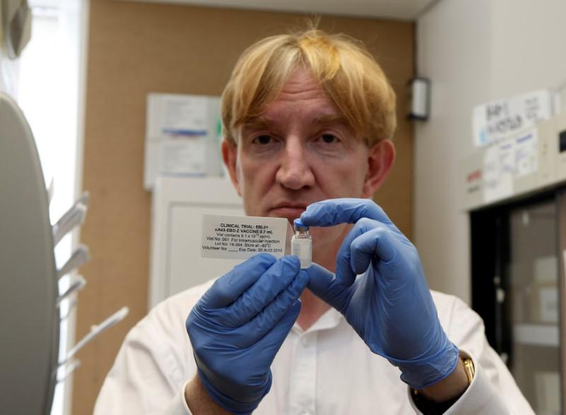 FILE PHOTO: Professor Adrian Hill, Director of the Jenner Institute, and Chief Investigator of the trials, holds a phial containing the Ebola vaccine at the Oxford Vaccine Group Centre for Clinical Vaccinology and Tropical Medicine (CCVTM) in Oxford
