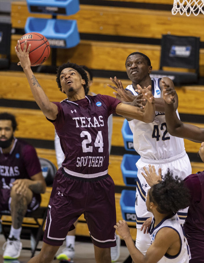 Texas Southern forward John Walker III (24) grabs a rebound next to Mount St. Mary's forward Malik Jefferson (42) during the second half of a First Four game in the NCAA men's college basketball tournament Thursday, March 18, 2021, in Bloomington, Ind. (AP Photo/Doug McSchooler)