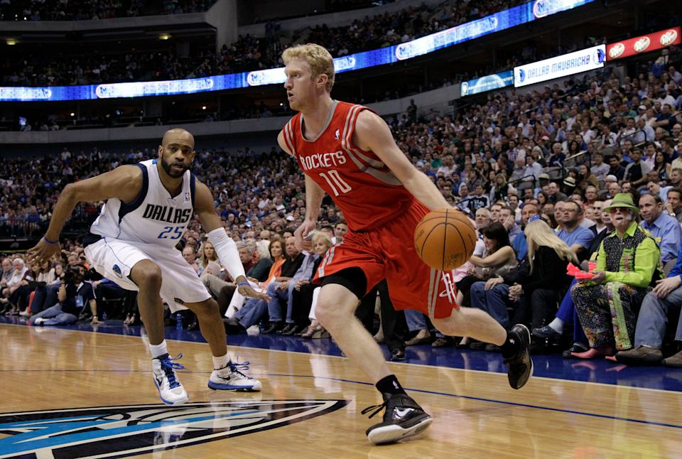 Dallas Mavericks' Vince Carter (25) and Houston Rockets' Chase Budinger during an NBA basketball game Tuesday, March 27, 2012, in Dallas. The Mavericks won 90-81. (AP Photo/Tony Gutierrez)
