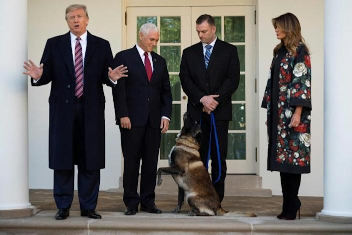 US President Donald Trump, Vice President Mike Pence and First Lady Melania Trump stand at the White House in November 2019 with Conan, the military dog that was involved in the operation that killed the leader of the Islamic State group, Abu Bakr al-Baghdadi (AFP Photo/JIM WATSON)