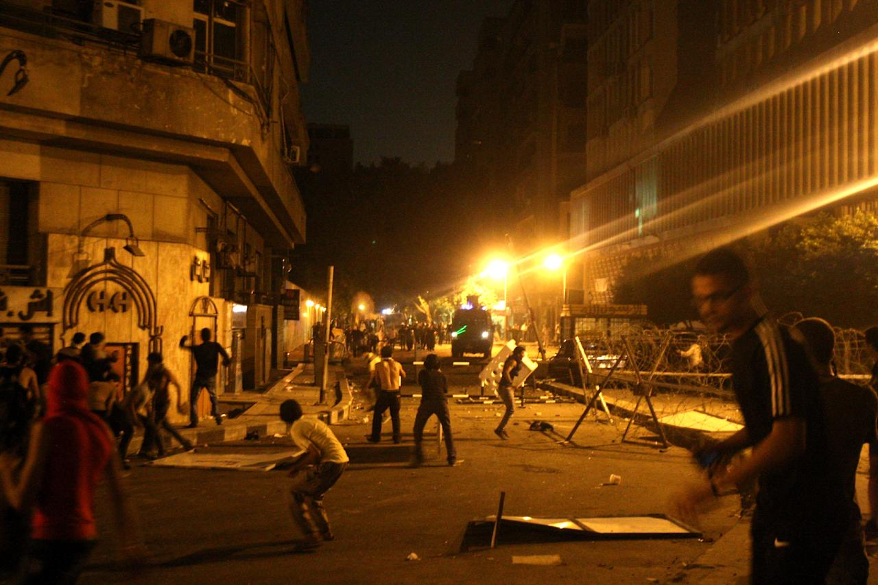 Protesters clash with police in front of the U.S. embassy in Cairo, Egypt, early Thursday, Sept. 13, 2012, as part of widespread anger across the Muslim world about a film ridiculing Islam's Prophet Muhammad.(AP Photo/Mohammed Abu Zaid)