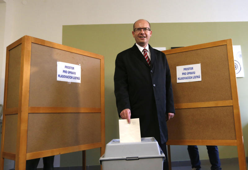 Chairman of Social Democratic party Bohuslav Sobotka casts his vote during early elections in Slavkov u Brna, Czech Republic, Friday, Oct. 25, 2013. Czech Republic holds the elections Oct. 25-26. Posters in back read: space for casting of ballots. (AP Photo/Petr David Josek)