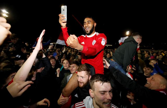 "Soccer Football - League Two - Accrington Stanley vs Yeovil Town - Wham Stadium, Accrington, Britain - April 17, 2018 Accrington Stanley's Erico Sousa celebrates with fans after winning promotion to League One Action Images/Carl Recine EDITORIAL USE ONLY. No use with unauthorized audio, video, data, fixture lists, club/league logos or ""live"" services. Online in-match use limited to 75 images, no video emulation. No use in betting, games or single club/league/player publications. Please contact your account representative for further details."
