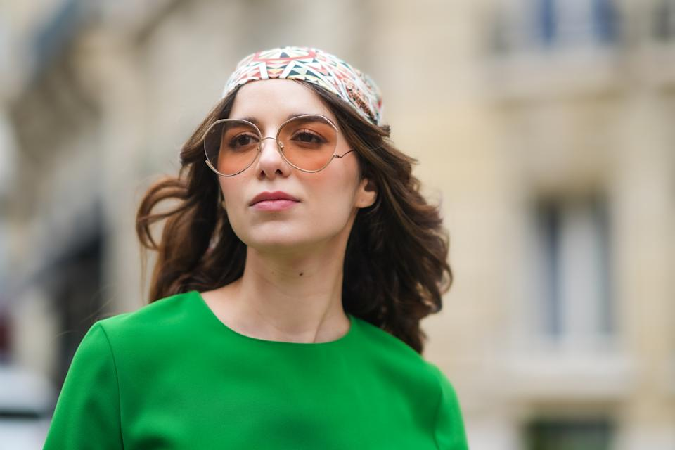 PARIS, FRANCE - APRIL 28: Ketevan Giorgadze @katie.one wears a midi green dress with a round neckline from Zara, oversized sunglasses from For Art's Sake, a silk scarf worn as a bandanna over the head, on April 28, 2021 in Paris, France. (Photo by Edward Berthelot/Getty Images)