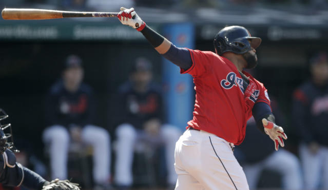 Cleveland Indians' Carlos Santana watches his RBI-single off Atlanta Braves starting pitcher Julio Teheran in the first inning during the first game of a baseball doubleheader, Saturday, April 20, 2019, in Cleveland. Jose Ramirez scored on the play. (AP Photo/Tony Dejak)