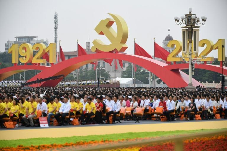 People attend celebrations marking the 100th anniversary of the founding of the Communist Party of China at Tiananmen Square in Beijing