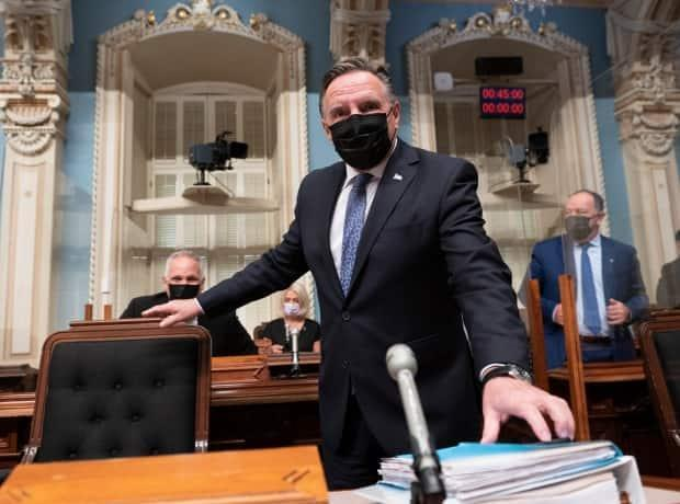 Quebec Premier Francois Legault walks in for question period Thursday, September 23, 2021 at the National Assembly Quebec City. His government tabled a bill to outlaw protests near places such as schools, hospitals and COVID-19 vaccination sites. (Jacques Boissinot/The Canadian Press - image credit)