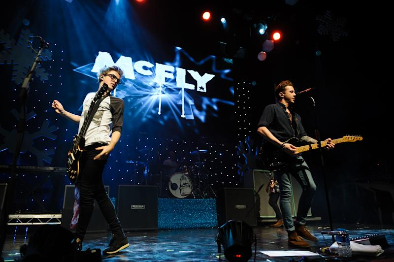 LONDON, UNITED KINGDOM - DECEMBER 03: Tom Fletcher and Dougie Poynter of McFly performs on stage for Magic Sparkle Gala at Indigo2 at O2 Arena on December 3, 2013 in London, United Kingdom. (Photo by Joseph Okpako/Redferns via Getty Images)