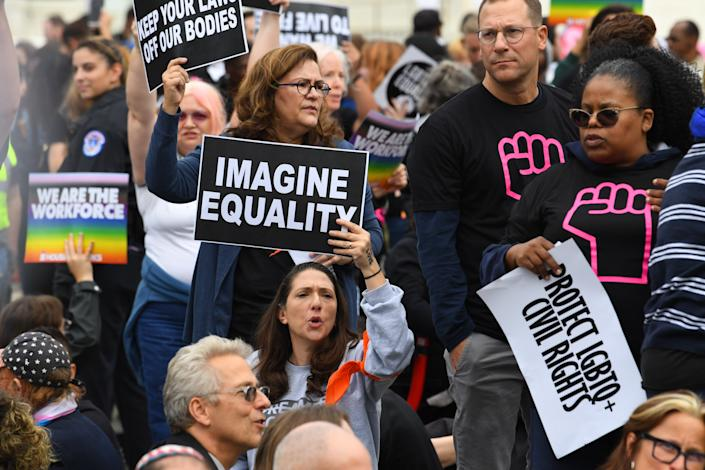 LGBTQ supporters gather in front of the U.S. Supreme Court on Oct. 8, 2019, as the justices hear three challenges from New York, Michigan and Georgia involving workers who claim they were fired because they were gay or transgender.