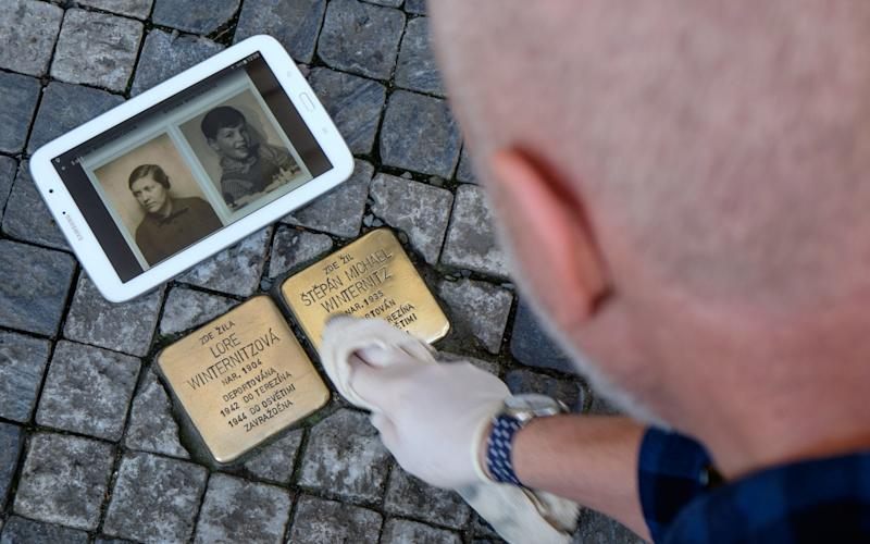Trevor Sage regularly takes to the streets of Prague to clean the 311 stones that mark where a Holocaust victim once lived - © 2018 James Fassinger