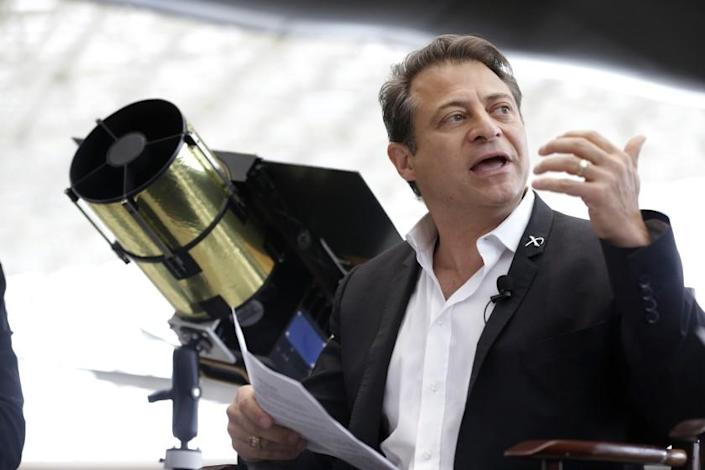 Peter Diamandis, co-chairman of Planetary Resources, an astroid mining company based in Bellevue, Wash., talks to reporters Wednesday, May 29, 2013, in Seattle about his company's plans for the world's first crowd funded space telescope. (AP Photo/Ted S. Warren)