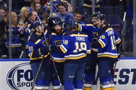 Mar 19, 2019; St. Louis, MO, USA; St. Louis Blues left wing Pat Maroon (7) celebrates with teammates after scoring during the third period against the Edmonton Oilers at Enterprise Center. Mandatory Credit: Jeff Curry-USA TODAY Sports