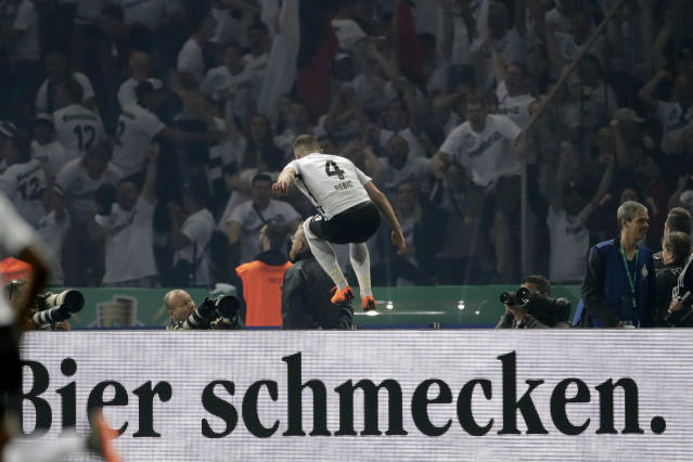 Frankfurt's Ante Rebic celebrates after scoring his side's second goal during the German soccer cup final match between FC Bayern Munich and Eintracht Frankfurt in Berlin, Germany, Saturday, May 19, 2018. (AP Photo/Michael Sohn)