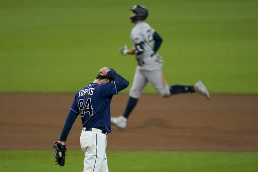 Tampa Bay Rays pitcher John Curtiss (84) reacts after giving up a grand slam home run to New York Yankees designated hitter Giancarlo Stanton during the ninth inning in Game one of a baseball American League Division Series Monday, Oct. 5, 2020, in San Diego. (AP Photo/Gregory Bull)