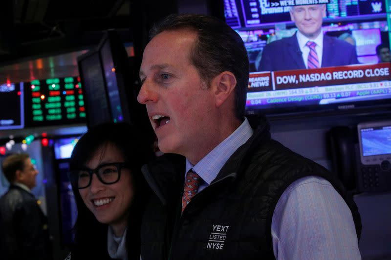 S&P 500, Dow eke out records; Nasdaq win streak ends