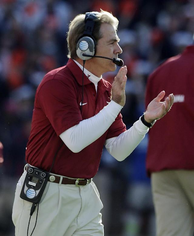 Alabama head coach Nick Saban applauds from the sidelines during the first half of an NCAA college football game against Auburn in Auburn, Ala., Saturday, Nov. 30, 2013. (AP Photo/Dave Martin)