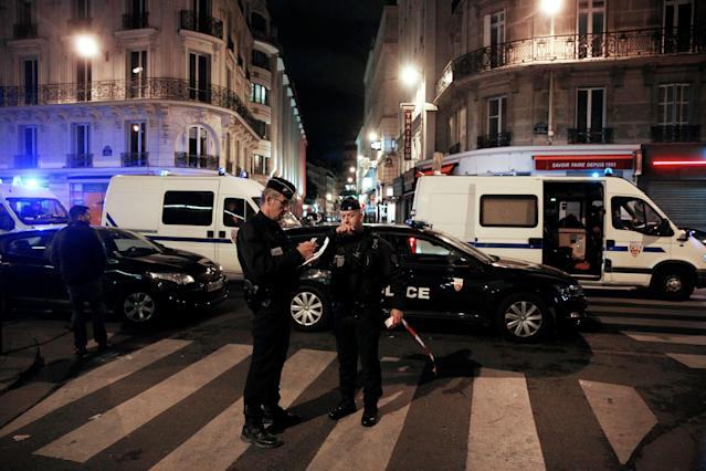 <p>Policemen stand guard in a street of Paris centre after one person was killed and several injured by a man armed with a knife, who was shot dead by police in Paris on May 12, 2018. (Photo: Geoffroy Van Der Hasselt/AFP/Getty Images) </p>