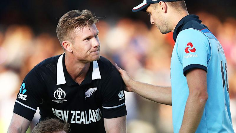 Chris Woakes consoles Jimmy Neesham after the heartbreaking super over saw England crowned champs. (Photo by Michael Steele/Getty Images)