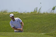 Dustin Johnson chips up to the sixth green on during the second round of the PGA Championship golf tournament on the Ocean Course Friday, May 21, 2021, in Kiawah Island, S.C. (AP Photo/Chris Carlson)