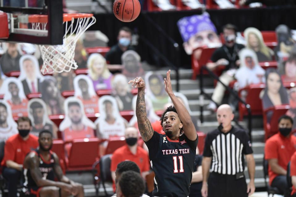 Texas Tech's Kyler Edwards (11) shoots the ball during the second half of an NCAA college basketball game against Baylor in Lubbock, Texas, Saturday, Jan. 16, 2021. (AP Photo/Justin Rex)